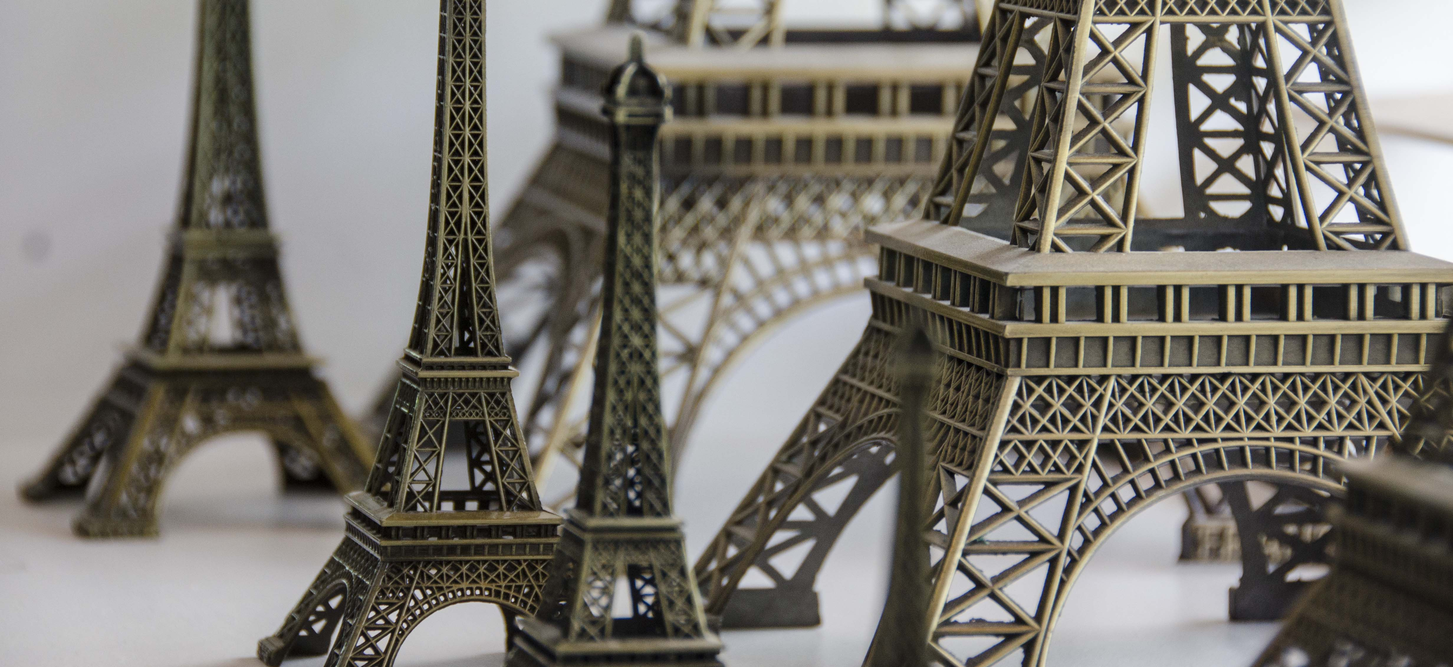 Several different sized Eiffel tower statues in the Snagged Office