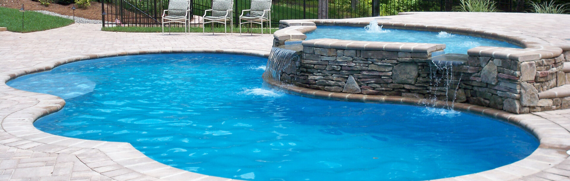 aquacade outdoor inground pool with waterfall and fountain