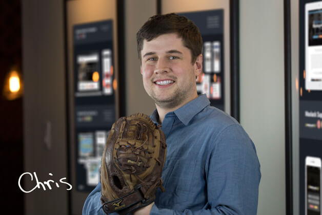 Headshot of Chris Brady holding baseball glove with his signature