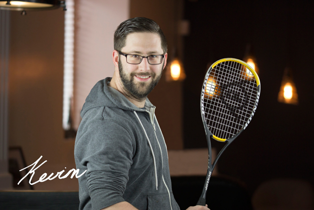 Headshot of Kevin Suchy holding tennis racket with his signature