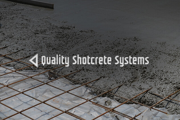 Quality Shotcrete Systems logo above construction site