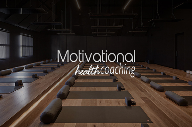 Motivational Health Coaching logo above room filled with yoga mats