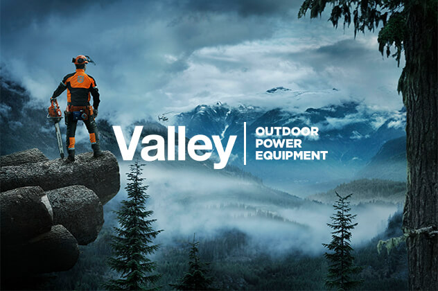 Valley Outdoor Power Equipment branding designed above man standing cliffside holding a chainsaw