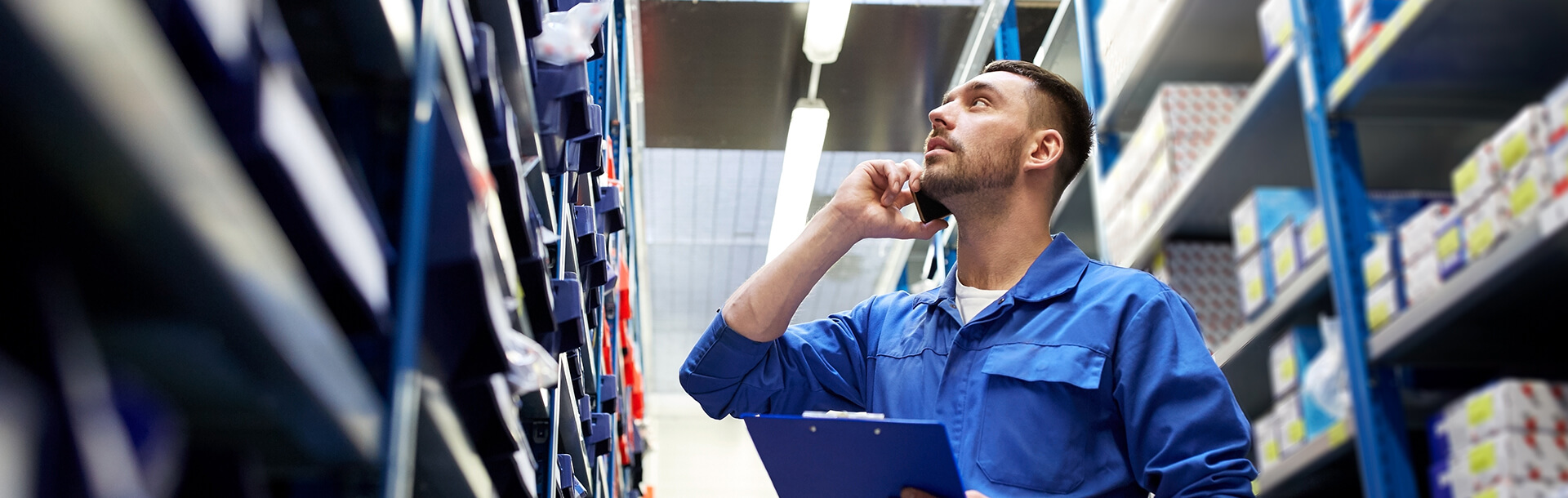 maslack employee looking at shelves while talking on cell phone